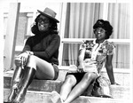 Two Women Sitting on Steps by North Carolina Agricultural and Technical State University