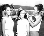 Three Women with 1969 A&T Hat by North Carolina Agricultural and Technical State University