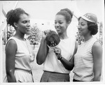 Three Women with '69 Cap by North Carolina Agricultural and Technical State University