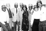 Eight People Wearing A&T Caps by North Carolina Agricultural and Technical State University