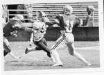 Football Player #11 Passing Ball by North Carolina Agricultural and Technical State University