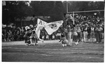 Football Player and Cheerleaders by North Carolina Agricultural and Technical State University
