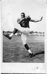 Football Player Posing by North Carolina Agricultural and Technical State University